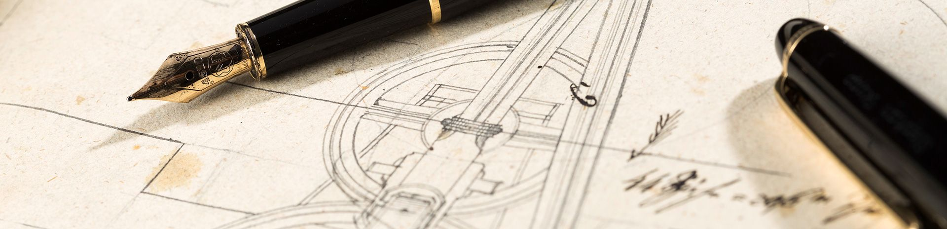 Pens laying on a technical drawing